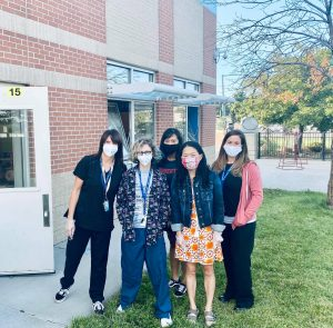 Staff in masks at school
